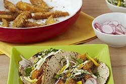 Polenta-Crusted Fish Tacos with Spicy Mango Slaw